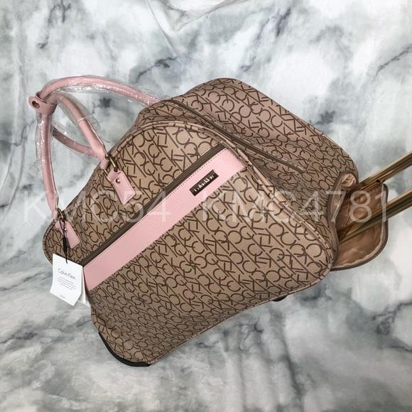 Calvin Klein Duffel Bag Rolling Luggage blush pink ddfc665308dc4